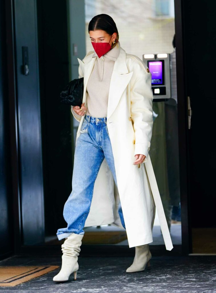 Hailey Bieber in a White Trench Coat