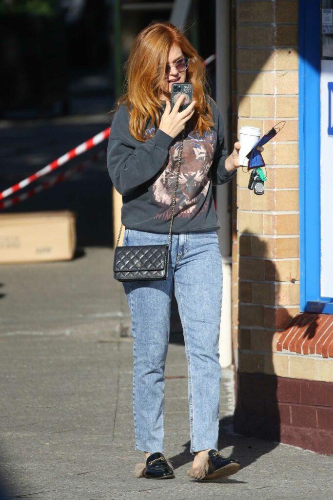 Isla Fisher in a Black Tiger Print Sweatshirt