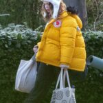 Lily James in a Yellow Puffer Jacket Was Seen Out in London
