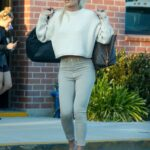 Lindsey Vonn in a Beige Sweater Carries Two Heavy-Looking Bags as She Exits a Photoshoot in Los Angeles