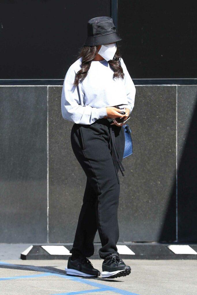 Lori Harvey in a Black Sneakers