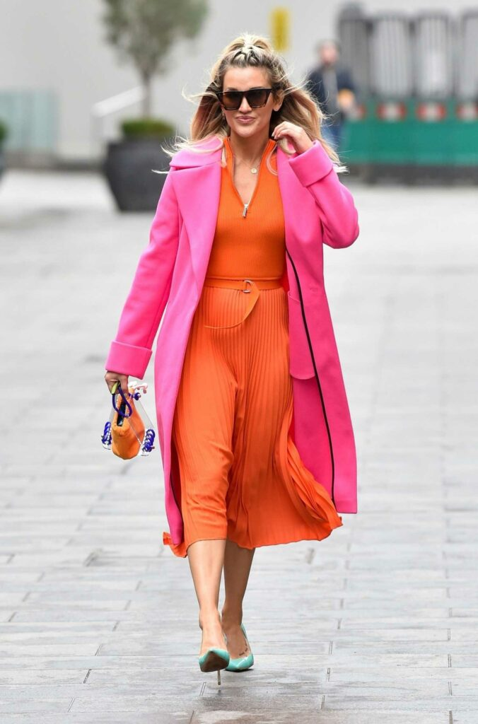 Ashley Roberts in an Orange Dress