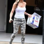 Caprice Bourret in a White Tank Top Takes the Bins Out in London