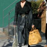 Chrissy Teigen in a Black Leather Coat Was Seen Out in New York