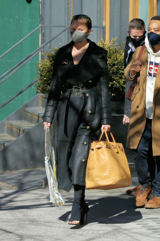 Chrissy Teigen in a Black Leather Coat