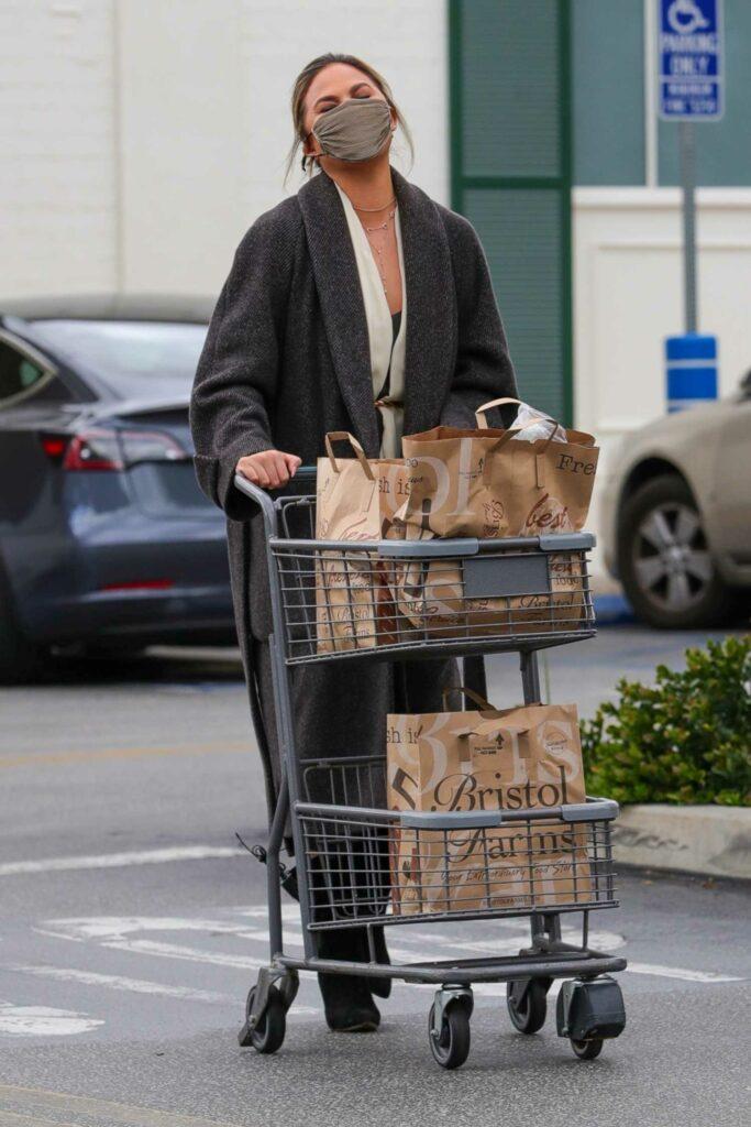 Chrissy Teigen in a Grey Coat
