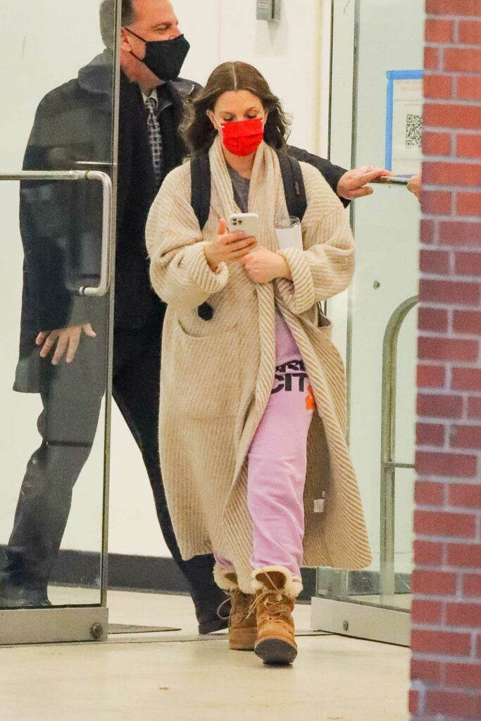 Drew Barrymore in a Red Protective Mask