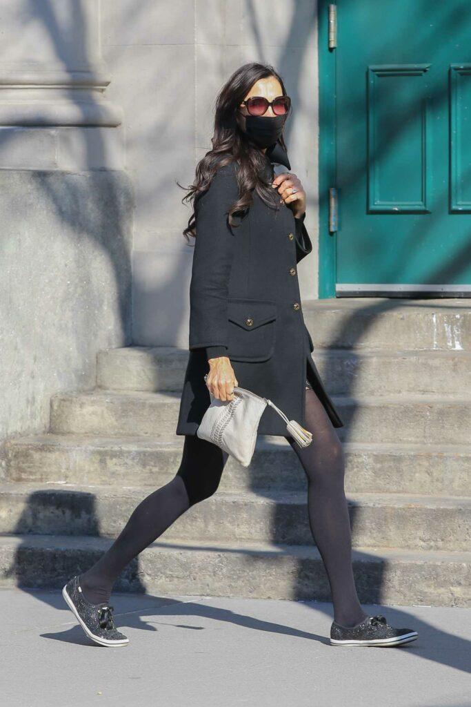 Famke Janssen in a Black Coat