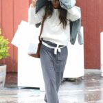 Jordana Brewster in a Grey Pants Was Spotted in a Rainstorm in Brentwood