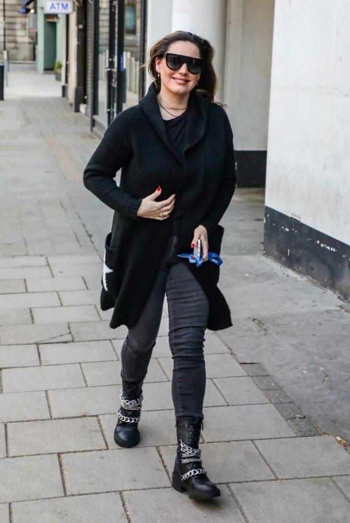 Kelly Brook in a Black Cardigan