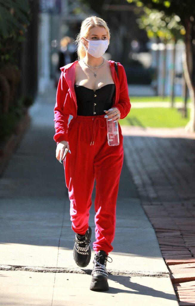 Lottie Moss in a Red Sweatsuit