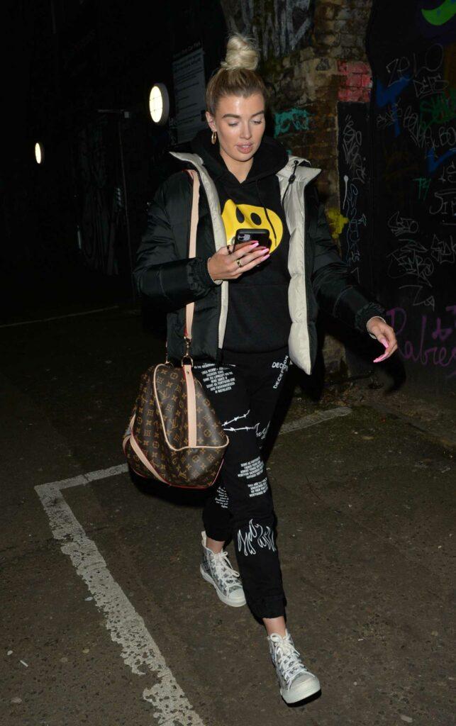 Nicole O'Brien in a Black Puffer Jacket