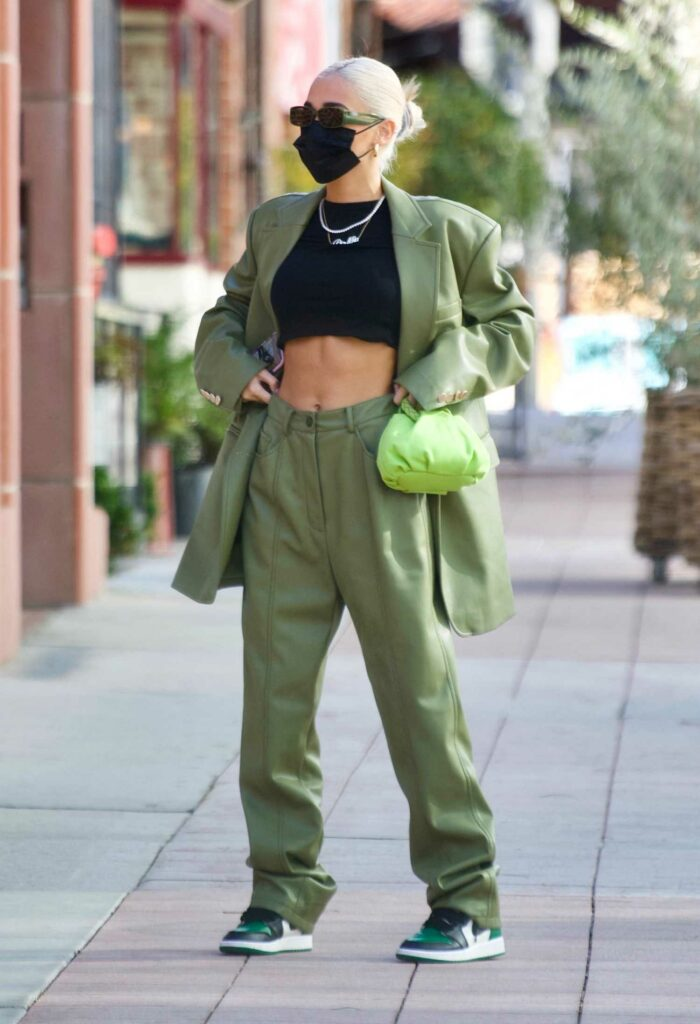 Pia Mia in a Green Suit
