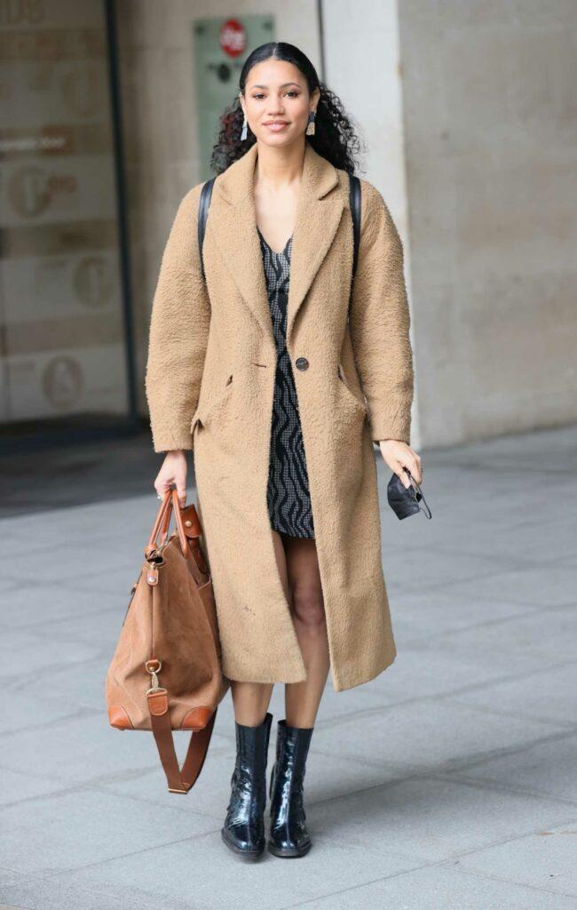 Vick Hope in a Beige Coat