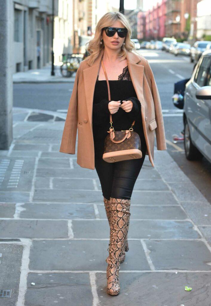 Amy Hart in a Tan Blazer
