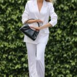 Charlotte McKinney in a White Outfit Leaves a Photoshoot in Los Angeles 04/21/2021