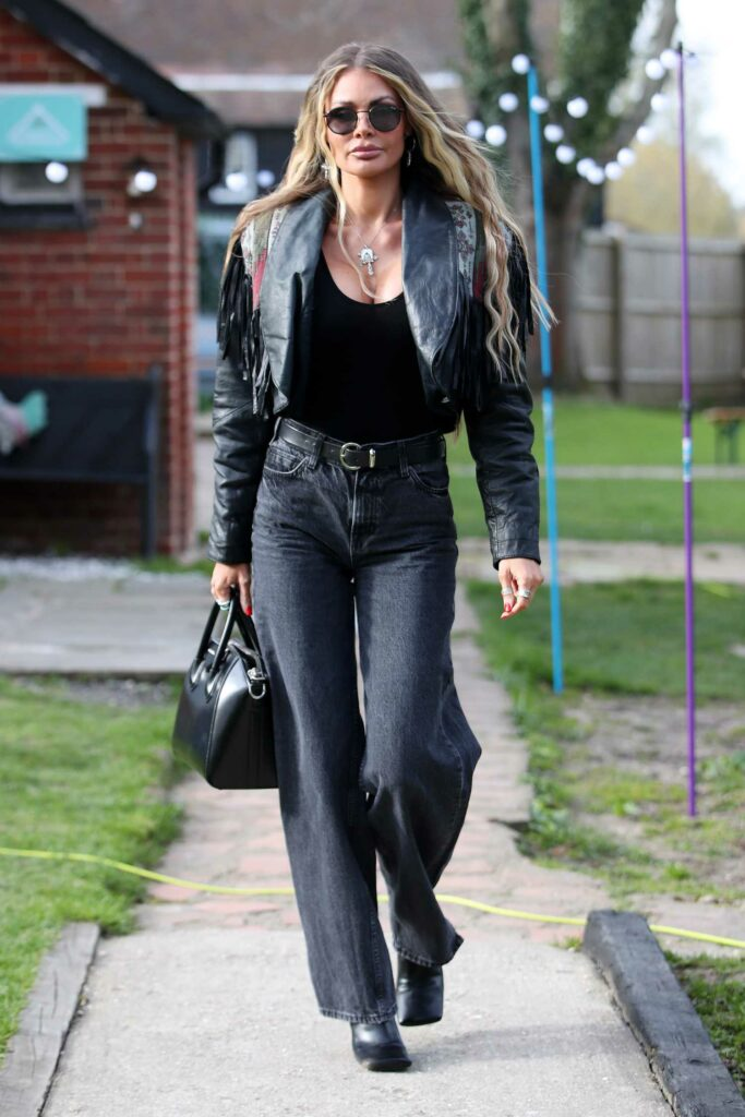 Chloe Sims in a Black Leather Jacket