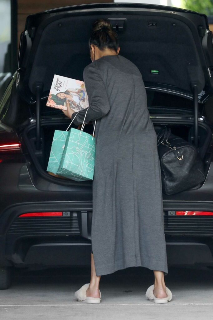 Chrissy Teigen in a Grey Cardigan