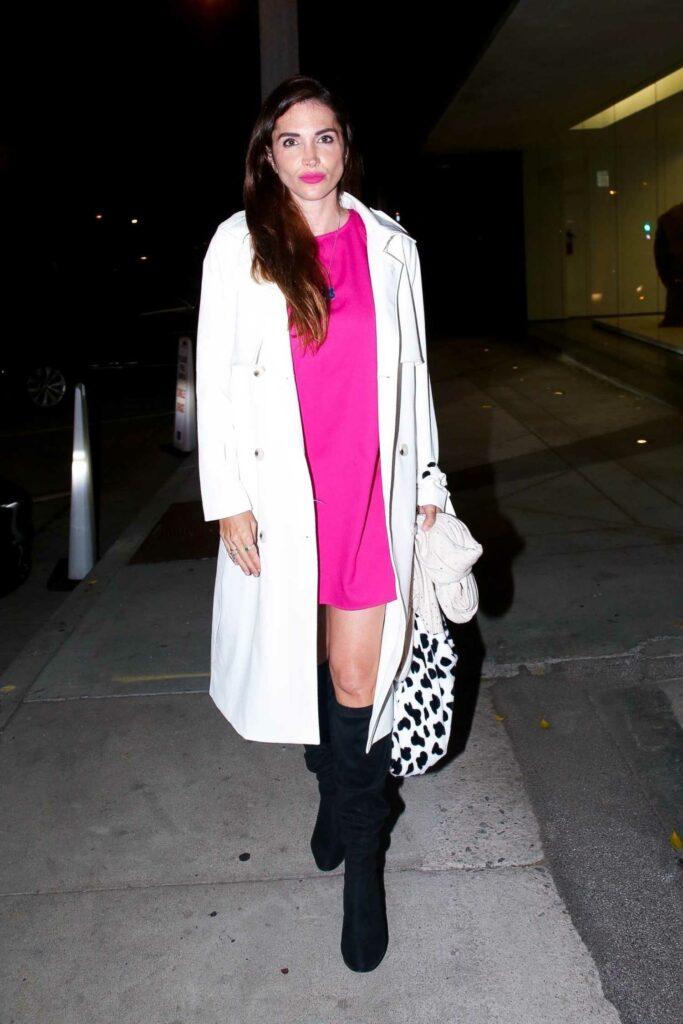 Elisa Jordana in a White Trench Coat