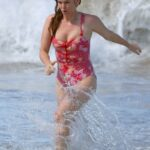 Isla Fisher in a Red Floral Swimsuit on the Beach in Sydney