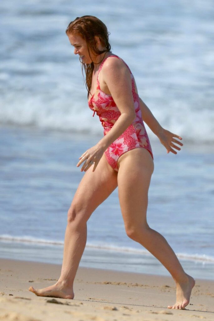 Isla Fisher in a Red Floral Swimsuit