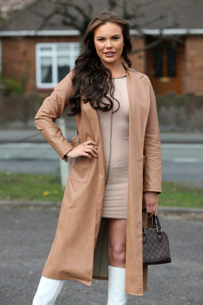Kelsey Stratford in a Tan Leather Coat