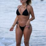 Larsa Pippen in a Black Bikini on the Beach in Miami