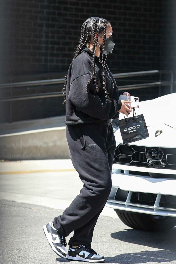 Lori Harvey in a Black Sweatsuit