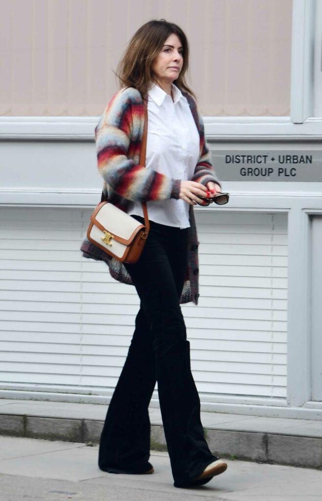 Sara Macdonald in a Striped Cardigan