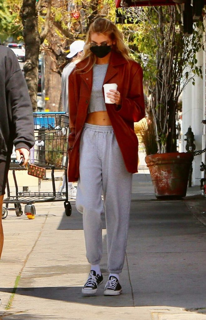 Stella Maxwell in an Orange Jacket
