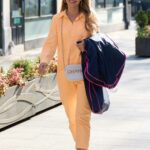 Vogue Williams in an Orange Jumpsuit Arrives at the Global Studios in London