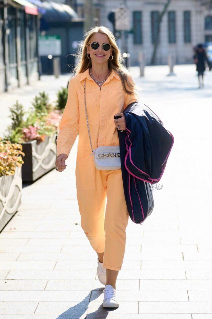 Vogue Williams in an Orange Jumpsuit