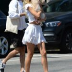 Alexis Ren in a White Mini Skirt Walks Her Dog in West Hollywood