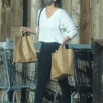 April Love Geary in a Black Leggings Goes Shopping at a Vintage Grocery Store in Malibu