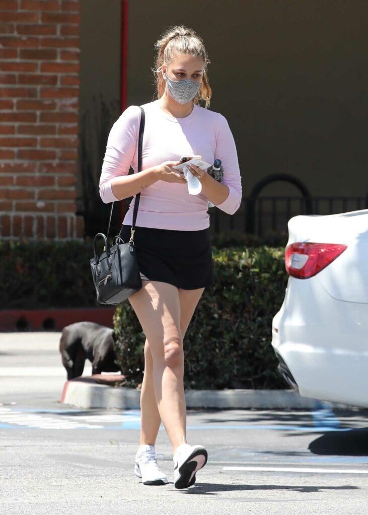 April Love Geary in a Black Mini Skirt