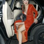 Caprice Bourret in an Orange Dress Arrives at the Arts Club in London