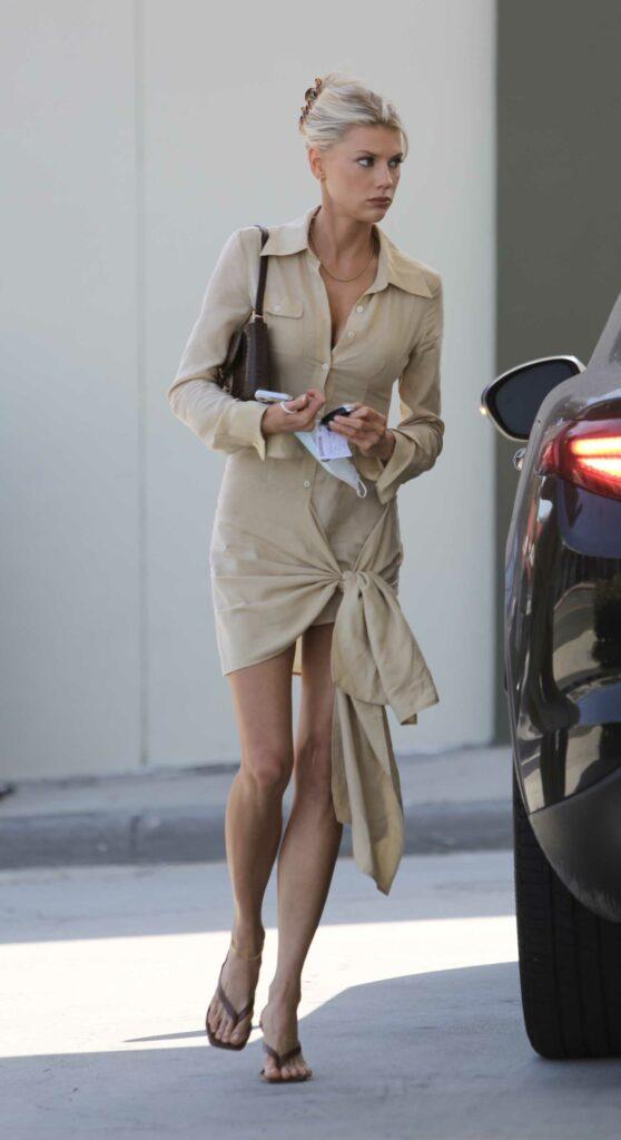 Charlotte McKinney in a Beige Dress