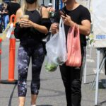 Emma Slater in a Black Protective Mask Arrives at the Farmers Market Out with Sasha Farber in Los Angeles