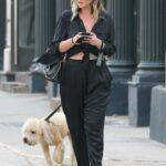 Georgina Burke in a Black Outfit Walks Her Dog in New York