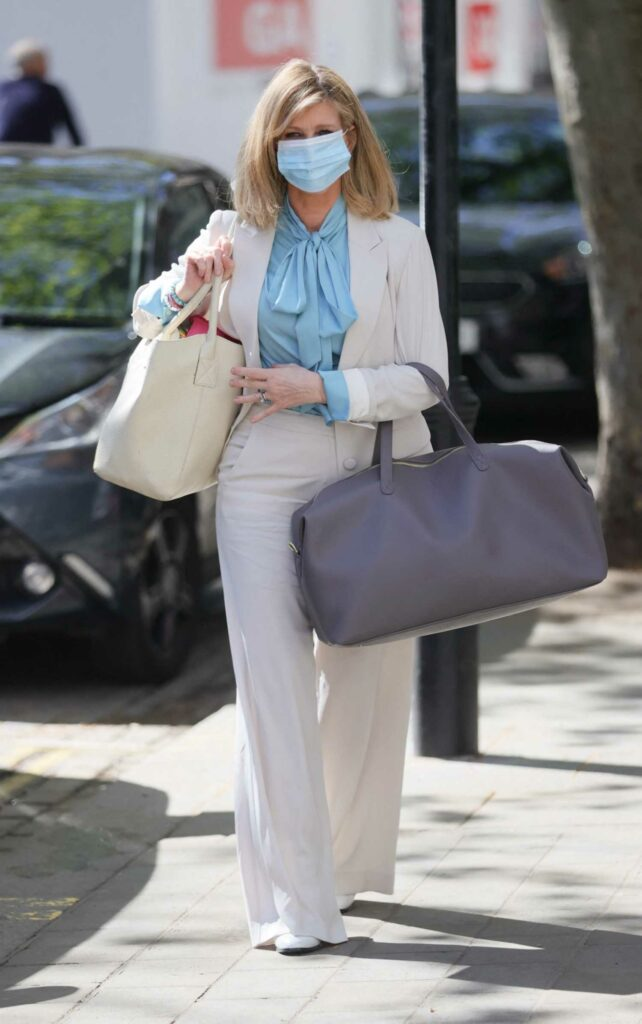 Kate Garraway in a White Suit
