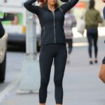 Kelly Bensimon in a Black Leggings Does a Workout on the Sidewalk in New York