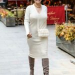 Kelly Brook in a White Knit Dress Leaves Her iHeartRadio Show at the Global Radio Studios in London