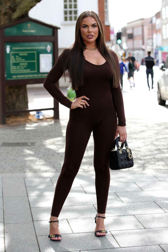 Kelsey Stratford in a Brown Catsuit