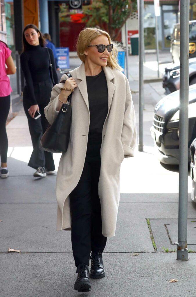 Kylie Minogue in a Beige Coat