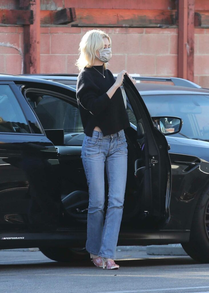 Nicola Peltz in a Black Sweater