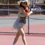 Phoebe Price in a Beige Mini Dress Hitting Some Tennis Balls at the Courts in Los Angeles