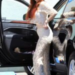 Phoebe Price in a Straw Hat Was Seen with Her Dog at the Parking Lot of Petco in Los Angeles