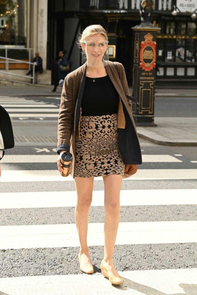 Rachel Riley in a Brown Blazer