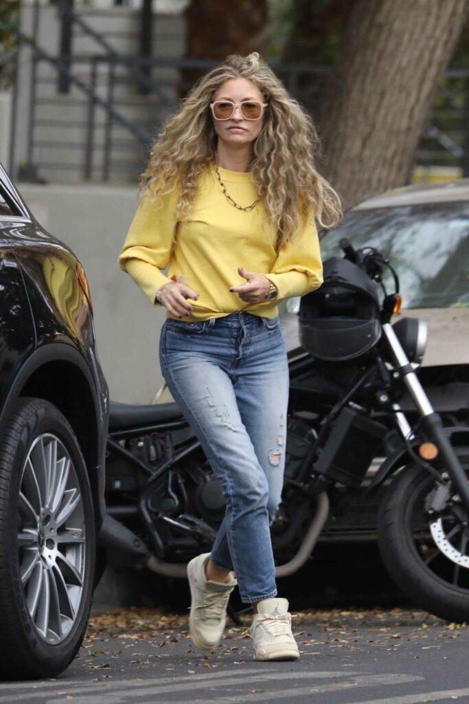 Rebecca Gayheart in a Yellow Sweatshirt