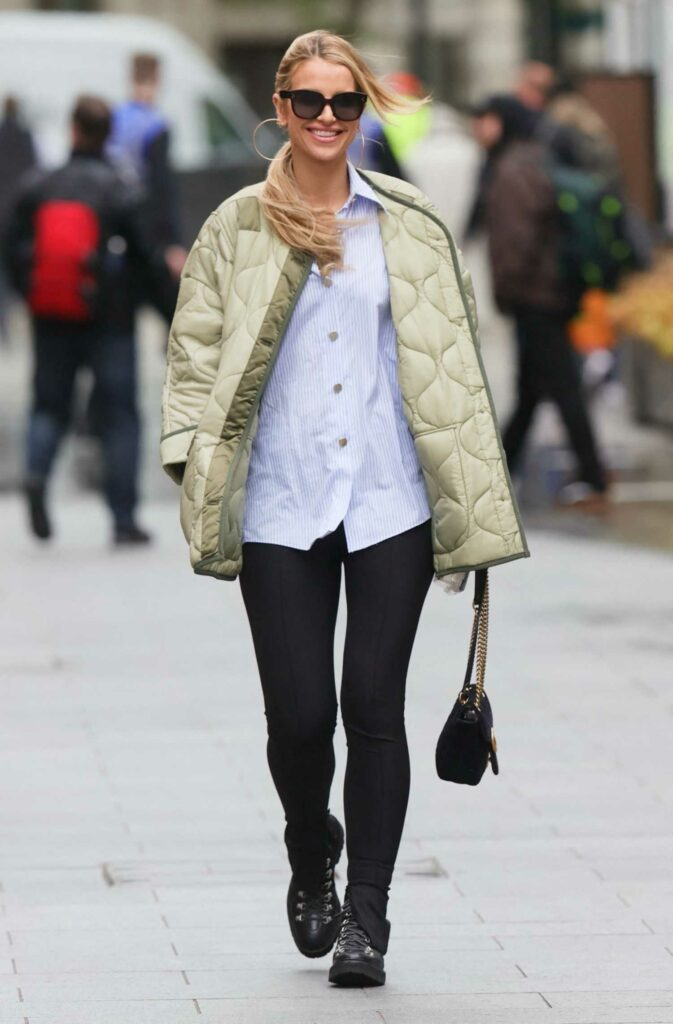 Vogue Williams in an Olive Quilted Jacket